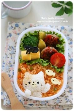 Cat themed bento box, featuring rice kitty & cheese fish atop fried rice