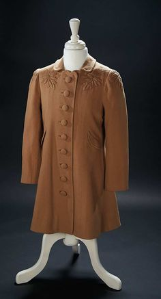 "Love, Shirley Temple, Collector's Book: 326 Brown Cashmere Woolen Coat Worn by Shirley Temple in the 1938 Film ""Little Miss Broadway"""