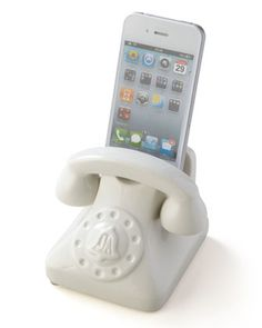 Retro-style smartphone holder. Made of high-fired porcelain with a high-gloss glaze finish. Accommodates most handheld devices. Notch in back allows holder to sit level when power cord is in place (po