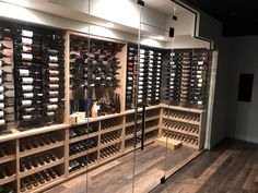 Transitional wine room w distressed wood, knotty alder wine racks, climate control, glass, led package and Joseph and Curtis wine cradles Just Wine, Mudroom Laundry Room, Knotty Alder, Climate Control, Wine Collection, Distressed Wood, Wine Racks, Wine Storage, How To Distress Wood
