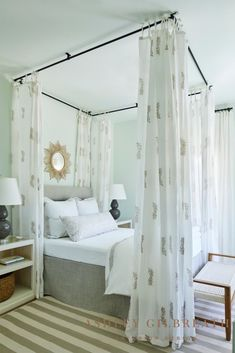 ASHLEY GILBREATH INTERIOR DESIGN: Honeydew green walls provide a soothing backdrop for suspended fabric panels framing the bed for an airy yet dramatic look. A rattan starburst mirror mounted above the upholstered headboard adds to the chic coastal look. Cute Home Decor, Cheap Home Decor, Ashley Gilbreath, Home Renovation, Home Remodeling, Luxury Homes Interior, Interior Design, Bunk Rooms, Bedroom Decor For Couples