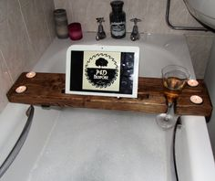 ***Please note processing time is up to 6 days now due to Christmas orders! *** Introducing our best seller , the bath caddy! It is handmade using Locally Sourced reclaimed Wood. It features a handy wine glass slot, 4 circular holes for holding tea light candles and a 30cm long