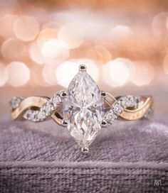 An absolutely stunning marquise diamond gold engagement ring with a twisting pave diamond shank. We love designing for the less-common center stone shapes. Using a marquise cut immediately sets your ring apart from the rest of the pack.