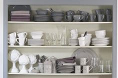 styling open shelves with every day dishes (wonder how the sippy cups will look?)  ;)