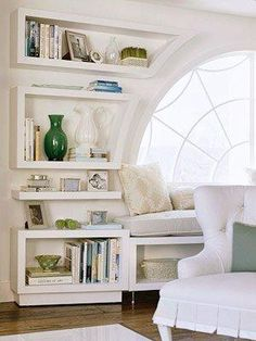 Shelves fit the arched window. They're interesting.