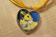 Jolteon with Togepi Pokemon necklace made from by CharmingSushi, £6.29
