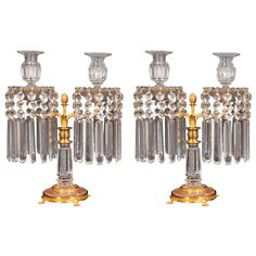 Pair of English Regency crystal candelabra | From a unique collection of antique and modern candleholders and candelabra at https://www.1stdibs.com/furniture/lighting/candleholders-candelabra/