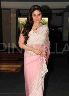 Sister-in-law Kareena Kapoor Khan arrived for Soha Ali Khan's wedding at their Khar residence on Sunday   Kareena wore a light pink Manish Malhotra saree for the occasion. Side swept h