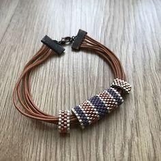 Mor, kahve, gümüş 💜 #miyuki #miyukilove #miyukibeads #miyukibileklik #miyukiaddict #handmade #handmadejewelry #handmadejewellery #madewithlove #simgenintakıları #leydimiyuki #izmir #izmirturkey #boncuk #takı #taktakıştır #aksesuar #jewellery #moda #fashion #purple #brown #silver #bileklik #bracelet #elemeği #tasarım #perlesmiyuki Beaded Jewelry Designs, Bead Jewellery, Jewelery, Handmade Jewelry, Loom Bracelet Patterns, Bead Loom Bracelets, African Bracelets, Bracelet Tutorial, Leather Jewelry