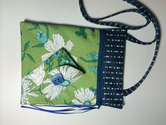 Handmade crossbody bag and wallet is made of Moda cotton fabric from the Color Me Happy collection. Large open pocket on back and zippered closure on front. Zipper pull is satin ribbon. 7 x 9 inches with 45 in. strap on bag. Wallet is made of same fabrics and has three card pockets as well as a coin pocket with Velcro closure. When closed it measure 4.25 x 3.25 inches and open is 4.25 x 8.5 inches. Tri-folds with Velcro closure. The bag and wallet are priced as a set for $32.00.