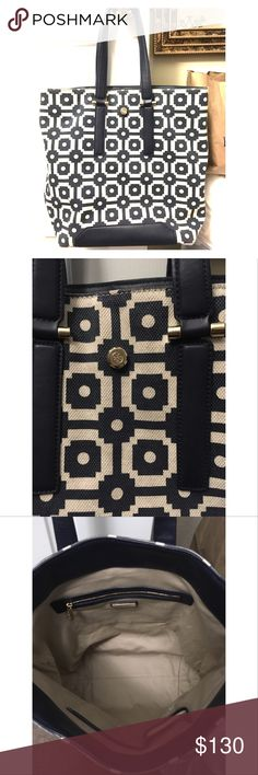 Tory Burch navy white canvas tote bag Beautiful barely used Tory Burch navy and white canvas tote bag. Bought in late 2015, only used a few times. One of those times was on a plane and a water bottle leaked and left a watermark on the lining about 1/3 way up from the bottom (see pics) otherwise EXTREMELY little wear! It's a pretty large tote bag too! See pictures and please ask if you have any questions! Tory Burch Bags Totes