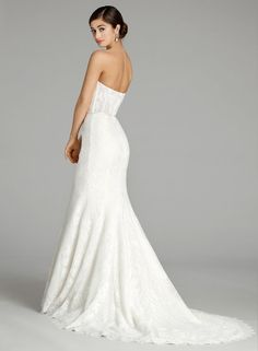 Style 9656 - Ivory lace trumpet bridal gown with a strapless neckline and sheer lace back.
