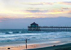 Huntington Beach, CA. I lived there once and LOVED it. I loved the climate and the ocean. One of my favorite sounds in the world is the sound of the ocean crashing on the beach early in the morning.    :)