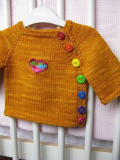 Ravelry: Evucis #37 Puerperium Cardigan. Love the rainbow buttons!