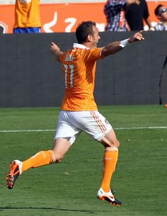 Brad Davis celebrates scoring the first ever goal at BBVA
