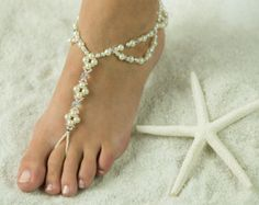 Starfish and Sea Shell, Barefoot Sandals, Foot Jewelry. Made with Tibetan Silver Starfish and Real Sea Shells. Handmade in all colors and made in your exact sandal size. Perfect for a Beautiful Beach Wedding. Bridal Party gifts to be loved forever.  Sexy Foot Jewelry, Barefoot Sandals with honeymoon lingerie. Our most popular Barefoot Sandals with Brides and her Bridesmaids, Flower Girl and Moms. We do recommend adding to your Barefoot Sandals with a matching Toe Ring, Anklet and/or Brac...
