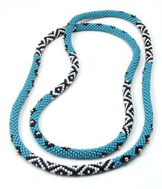 Turquoise and Sterling Silver Bead Rope. 52 inches long.