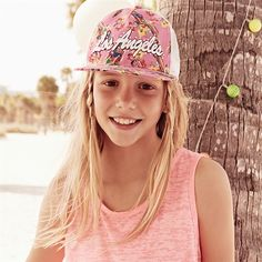 These slogan print hats are all trend this season.
