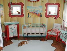 Vintage Circus Nursery....Full shot of the back wall of our vintage circus inspired nursery! Kalon Caravan Crib...painted to match color scheme and added red spigot wheels....chalkboard paint along bottom so that I can change out quotes. Painting above crib is a giclee on canvas by Alison Jay. Refurbished prim kitchen cabinet made into an ice cream cart changing table. Made hot air balloon and rabbit in basket.