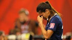 Amel Majri of France looks dejected