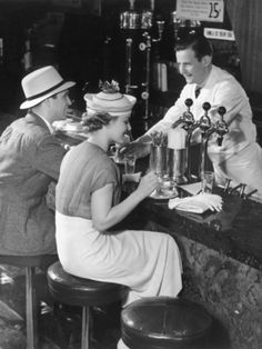 Vintage Images of people in the and enjoying drinks at a malt shop/ Soda Shop. Plus brief history of the Malt Shop.