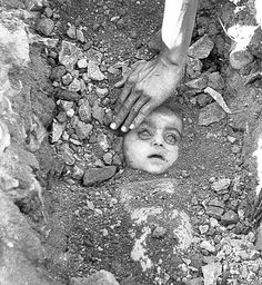 The dead body of a child is dug out who died during the gas tragedy by Union Carbide in Bhopal.
