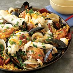 This hearty paella is brimming with browned chicken, spicy chorizo, and briny shellfish. For a faster version, omit the sole and crabmeat. Fish Recipes, Seafood Recipes, Mexican Food Recipes, Great Recipes, Cooking Recipes, Favorite Recipes, Spanish Recipes, Spanish Cuisine, Recipies