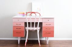 ...desk and chair over at Vintage Revivals, painted in a pink and white color block effect. I love the small accent of color at the very top and bottom of the chair!