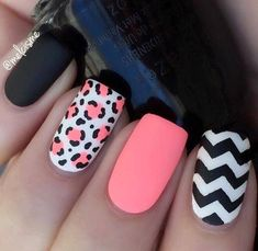 This matte manicure contains a mixture of pinks, blacks, and gorgeous leopard print details; the black and white chevron pattern tops off a stunning look. #summernails #nailart