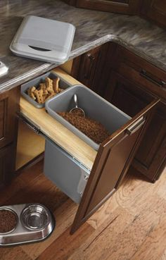 The base cabinet with waste basket. This picture shows it can be used for more than just garbage. Cabinet Options | Custom Kitchen & Bath Cabinets | Kemper | 41 Lumber