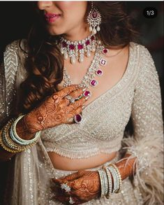 Stunning engagement look with an ivory gold monotone outfit with feather trimmings and a gorgeous diamond and ruby necklace #wittyvows #rubynecklace #ruby #diamondnecklace #engagement #lehenga #hennatattoo #hennadesigns Indian Wedding Poses, Indian Bridal Wear, Indian Wedding Photography, Indian Wear, Wedding Frocks, Wedding Outfits, Mehendi Outfits, Green Velvet Dress, South Asian Bride