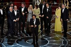 """Alejandro G. Inarritu, center, and the cast and crew of """"Birdman or (The Unexpected Virtue of Ignorance)"""" accept the award for the best picture at the Oscars on Sunday, Feb. 22, 2015, at the Dolby Theatre in Los Angeles. (Photo by John Shearer/Invision/AP)"""