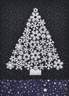 "Snowflake tree quilt:  White Christmas, 40 x 42"", in navy and silver.  Pattern/kit at Along Came Quilting.  Design by Kellie Wulfsohn."