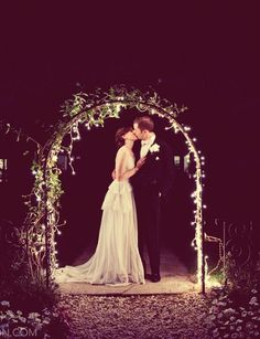illuminated bride + groom in twinkling arch | via: jessica johnston photography