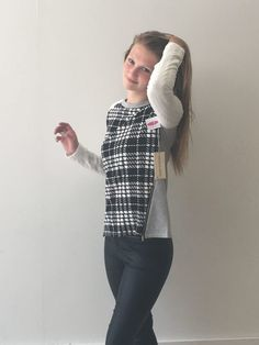 Outspoken Elevate your casual look with this sassy sweater. Classic black and white colors with a check pattern that adds a fun twist. The side zippers bring in your waistline while the casual padded sleeves make it perfect for the fireside.