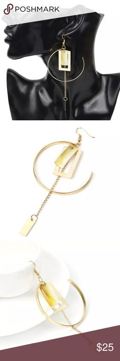 1 pc. geometric open circle w/shell & chain & bar 1 pc. geometric 5.5 cm. LARGE open circle w/rectangular shell with chain and bar dangling total of 12 cm exaggerated to be extra long as this is meant to be a STATEMENT piece worn alone with no other earring! This was meant to be worn alone as one earring but I do have two if you want to wear them on both ears. If you purchase both as a set I will take 10% off listed price. Gorgeous piece...I dare you to be different!!! It's the only way to…