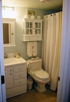 Bathroom Decorating Ideas Above Toilet add more shelving space to your small bathroom with over the