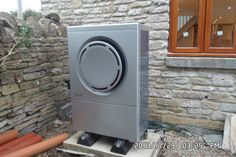 A Danfoss DHP AQ air source heat pump installed for a Corfe stone holiday cottage in Swanage, Dorset by award winning renewables company NGPS ltd.