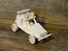 Handmade original design wood toy dune buggy ATV. 10 1/2 inches long and 5inches wide, wheels all turn and comes with 1 little wood person for
