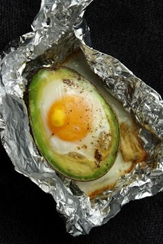 easy breakfast! 1 half of an avocado, pitted 1 egg Salt and pepper, to taste Topping of choice (some suggestions: parmesan, chili flakes, balsamic, oregano, basil, bacon, etc.) Preheat oven to 375°F. Using a small piece of aluminum foil, create a 'bowl' or 'boat' in which to bake your Eggvocado