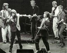 Paul McCarney, Mick Jagger, Mark Knopfler, David Bowie, Mark King and Bryan Adams