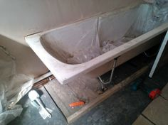 32.)  Andy arrives in the aft to pull the bath out of the wall a bit due to it disappearing into almost nothing at this end.  Did a good job...
