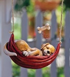 Daydreaming Puppy Hanging Garden Sculpture, In Puppy by Plow & Hearth. $19.95. Cuddly daydreaming animals. Snuggling in hammocks suspended from twine, these adorable resin animal garden sculptures are having sweet dreams of their favorite things. Durable enough for outdoors, they add a smile to a tree, deck or porch. Each dreamy object hovers overhead with a spring.