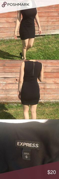 Express dress N.067 Perfect little black dress for any occasion! Great condition! Only flaw is 2 little holes on the inside on the lining. Not noticeable since it's on the inside of the garment. Express Dresses