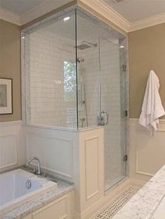 Pretty much our exact shower/bath situation except we have tile. This is an interesting altrrnative if we ever get tired of tile or need to replace it---Glass shower enclosure...panels on shower. The only way to a glass enclosed shower is this, much more updated and classy.