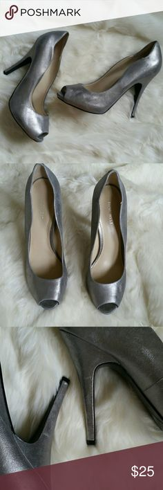 🍁 Silver peeptoe Nine West pumps Beautiful silver Nine West peeptoe pumps.  Scalloped design around the ankle.  Soft leather material.  Like new condition. Heel height 4.25 inches. Nine West Shoes Heels