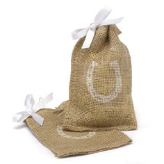 Horseshoe Burlap Wedding Favor Bag Set includes 25 favor bags. Each bag is made of textured, sepia brown burlap. The top of the favor bag features a twine drawstring closure and a white ribbon accent. The front of each bag is printed with a white horseshoe.