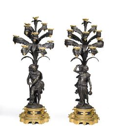 A pair of Napoleon III gilt and patinated bronze figural ten-light candelabra second half 19th century