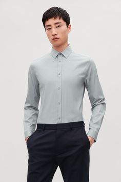 This slim-fit shirt is made from a lightweight cotton-mix with a comfortable stretch finish. A modern style, it has a narrow pointed collar, pearlescent buttons and a subtly curved hem. Back length of size 39 is / Model is tall and wearing a size 39 Shirt Dress, Grey, Fitness, Model, Cotton, Mens Tops, How To Wear, Ship, Search