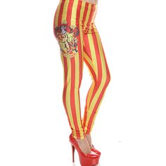 red yellow gryffindor banner print elastic waist skinny leggings ($19) ❤ liked on Polyvore featuring pants, leggings, harry potter, redyellow, skinny leggings, white pants, white leggings, white skinny pants and stripe leggings